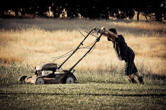 kid moving lawn